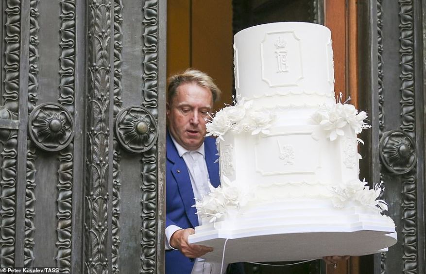 A cake mockup is delivered at the Russian Museum of Ethnography for a reception marking the wedding of Grand Duke George Mikhailovich of Russia, a descendant of the Romanov dynasty, and Rebecca (Victoria) Bettarini of Italy.