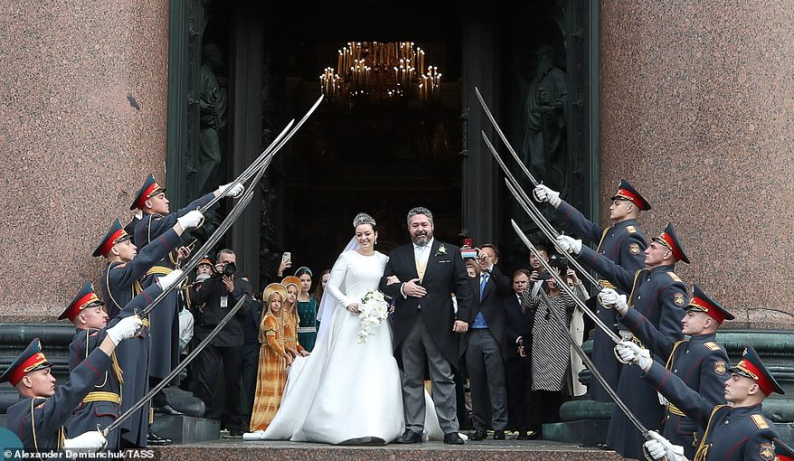 Rebecca and Grand Duke George Romanov beamed as they walked out of the cathedral arm-in-arm after tying the knot