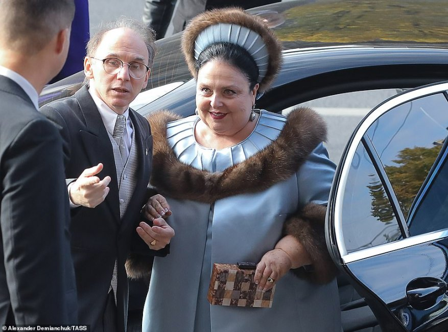 Grand Duchess Maria Vladimirovna of Russia arrives at St Isaac's Cathedral for her son's wedding. The mother-of-the groom carried a small box clutch to complement her fur trimmed outfit.
