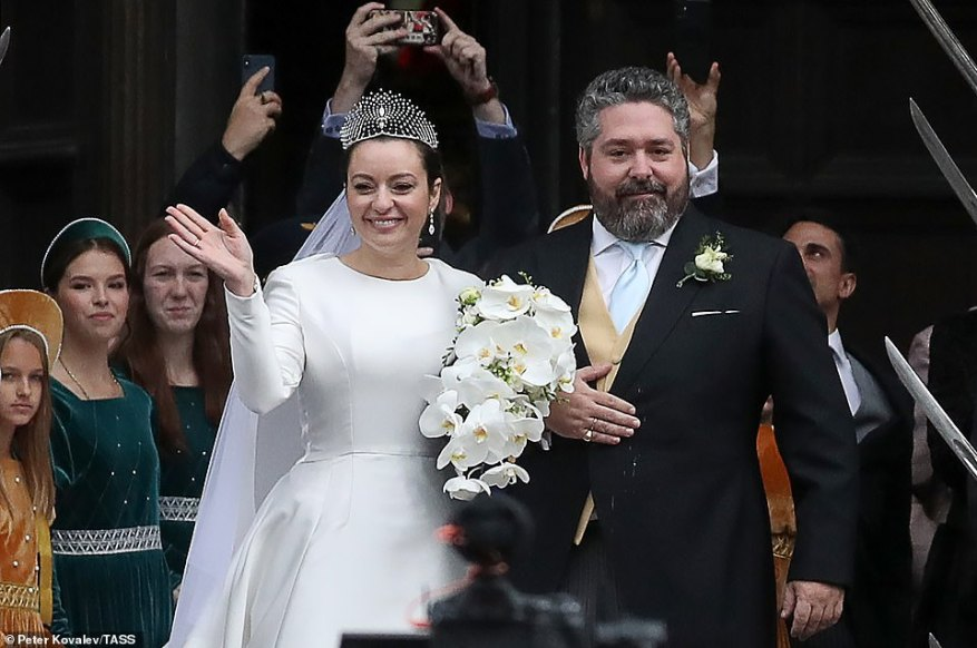 Rebecca beamed widely as she waved to crowds waiting outside the cathedral shortly after the wedding with Grand Duke George.