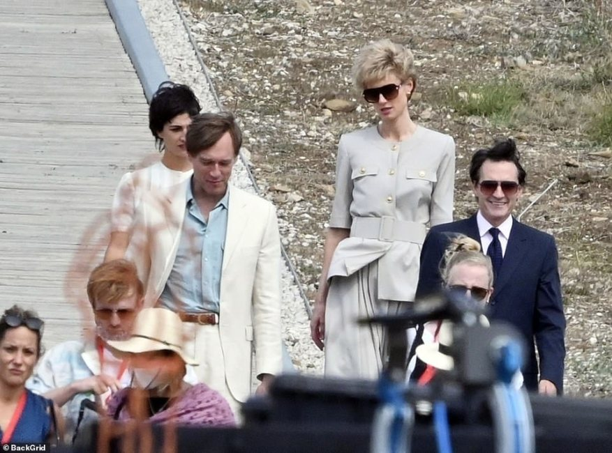 Recreation: Elizabeth recently filmed at Dunsfold Aerodrome, Surrey ¿ recreating a scene thought to be the family arriving for a royal flight to Italy