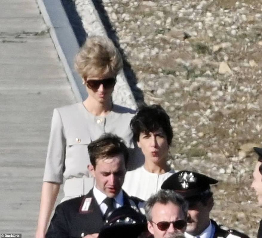 In character: Elizabeth appeared to be flanked by security as she filmed the scene
