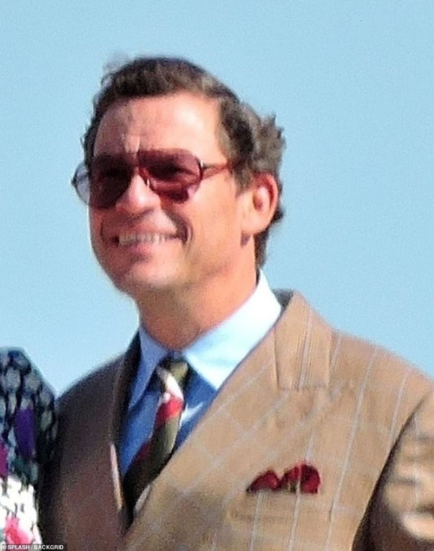 Dapper: Dominic West teamed his smart suit with a red and green tie while also wearing stylish shades