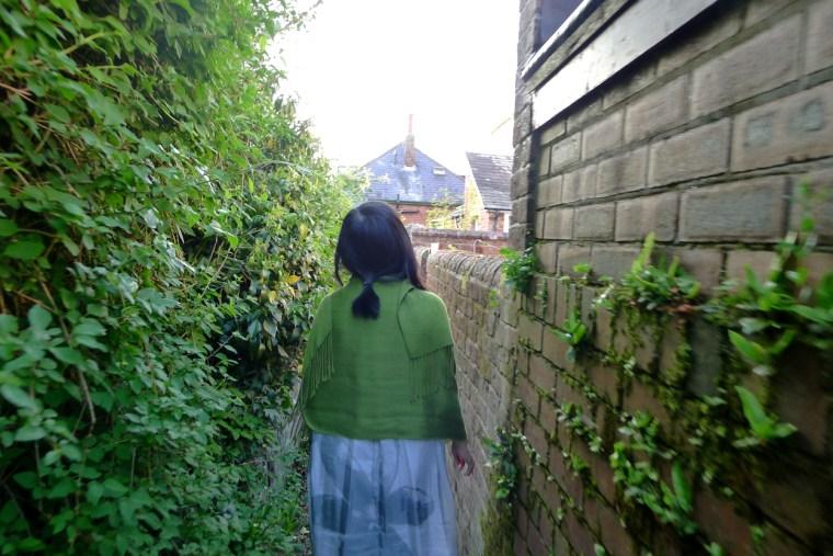 Yoke Sum leading us back from the garden