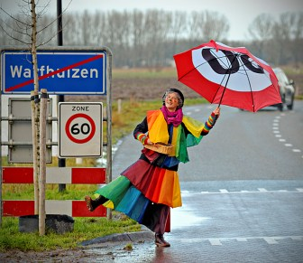 We keep it light, that's me dressed in my rainbow umbrella costume