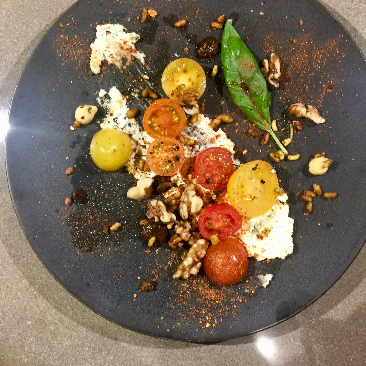 Tomato salad with sheep cheese and granola.