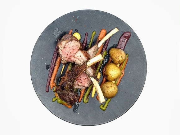 Lamb chops with mojo sauces and potatoes.
