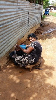 A Tamil woman washing. The Tamils manage to make the best of a harsh situation.