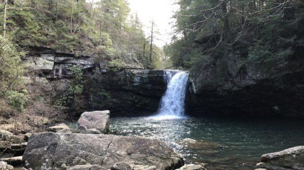 Narrow waterfall emptying into pool below