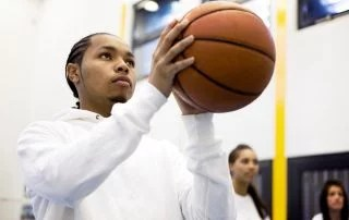 Basketball player focusing on taking a penalty shot in high school sports
