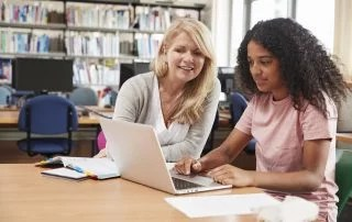 Student Has customized instruction From Teacher In Library