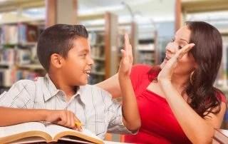 International Students: Hispanic International Student and Teacher Working in Library.