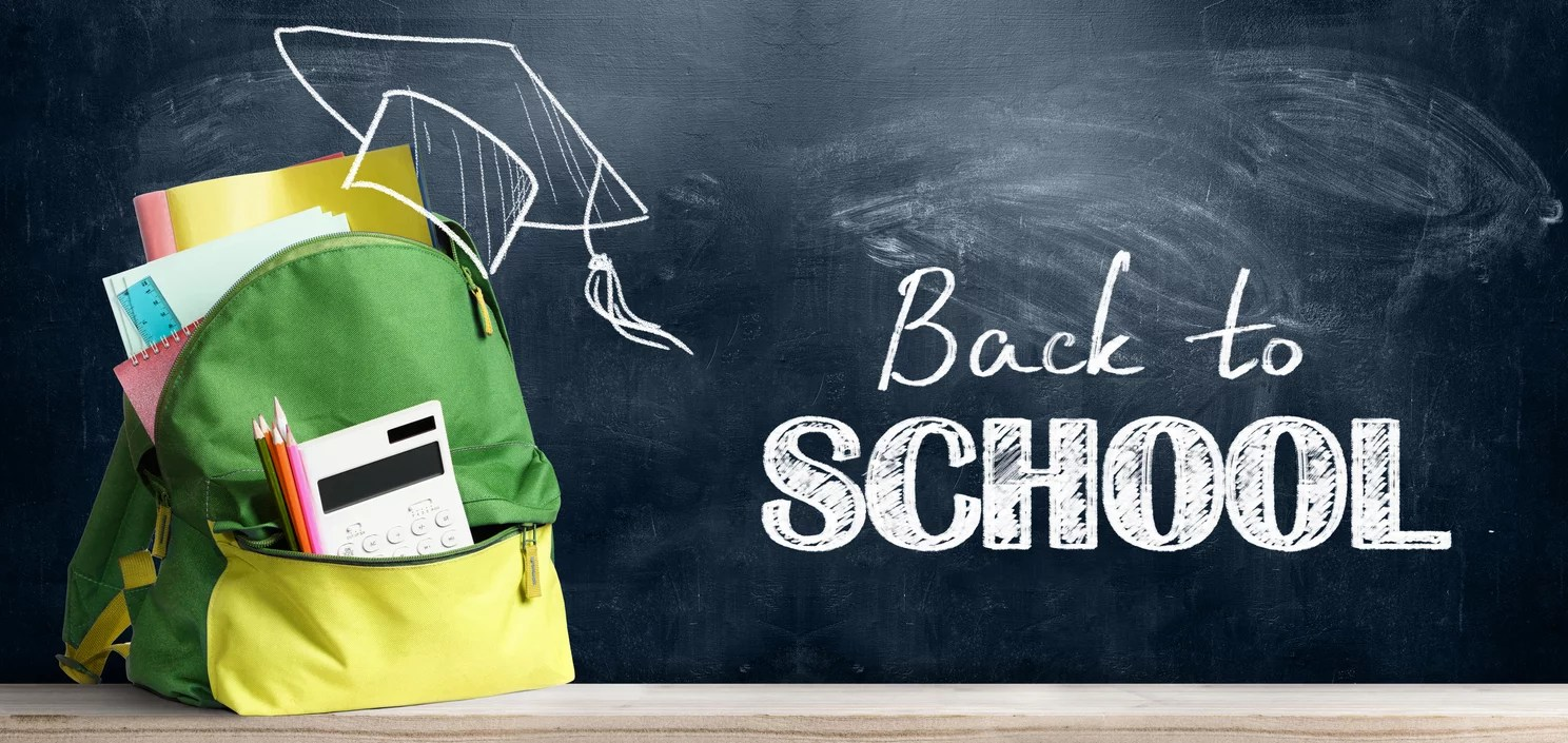 Back to school season shopping backpack. Accessories in student bag against chalkboard