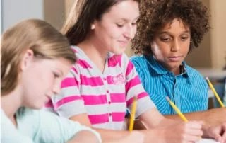Multiethnic students writing and dealing with dyslexia and dysgraphia