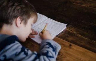 Young student taking written exam