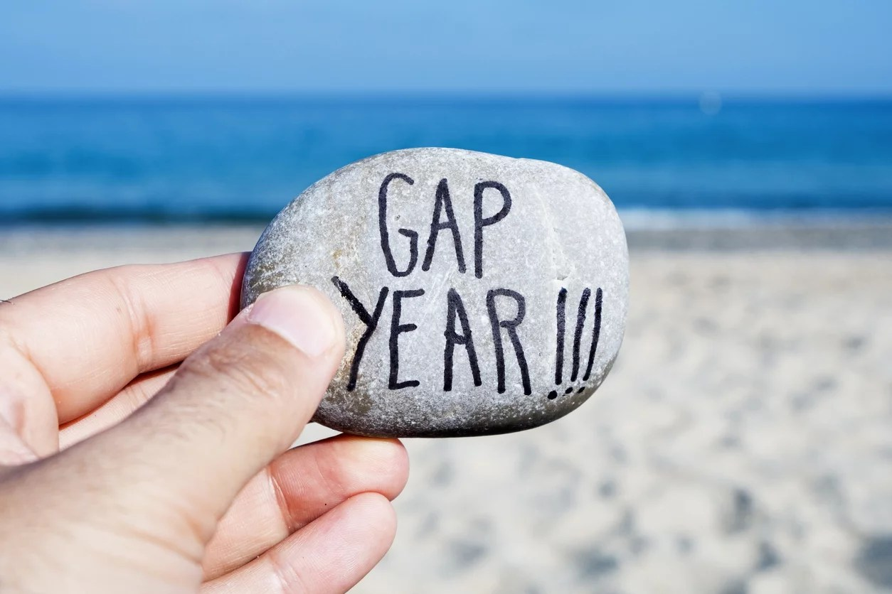 man-holding-rock-gap-year