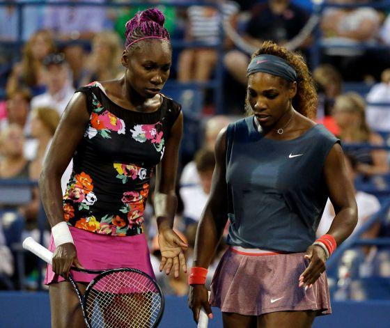 Serena and Venus Williams play doubles at the 2013 US Open