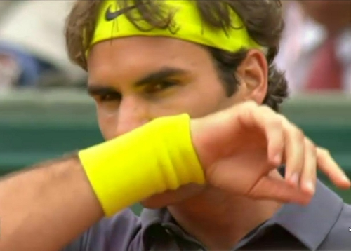 Roger Federer French Open yellow wristband wiping face intense eyes photos pictures images screencaps