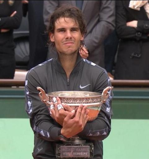 Rafael Rafa Nadal trophy taped fingers hug Roland Garros French Open 2012