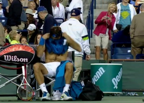 Roger Federer fan shirtless Rog blue shirt white shorts pictures