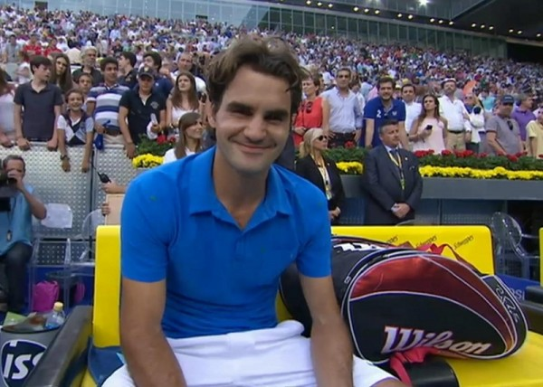 Roger Federer smile blue polo white shorts Mutua Madrid Open tennis bag Wilson photos pictures images screencaps