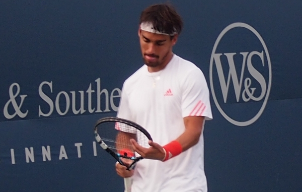 Fabio Fognini tongue raspberry sputtering racquet talking looking down white shirt red wristbands Cincinnati Open 2012 images photos pictures