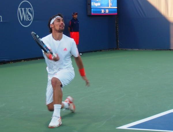Fabio Fognini Western and Southern Open Pospisil match kneeling forehand passionate expression white photos pictures images 2012