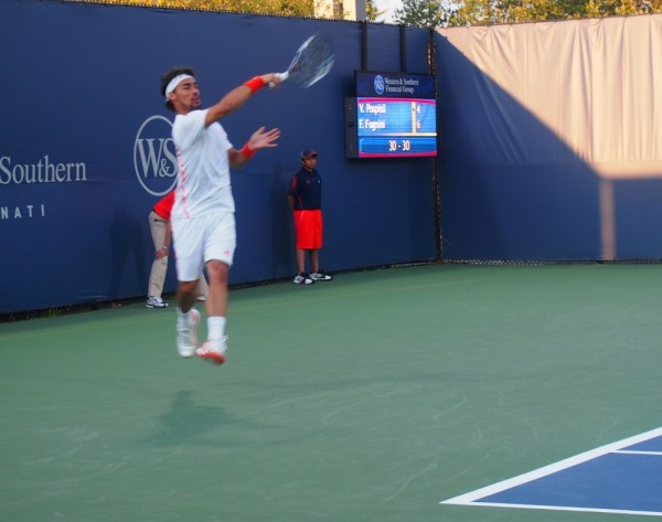 Fabio Fognini flying forehand white kit red shoes wristbands tongue racquet pictures photos images Cincinnati Open 2012