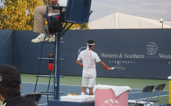 Fabio Fognini talks to court hand wave racquet Cincinnati Western and Southern Open 2012 pictures photos
