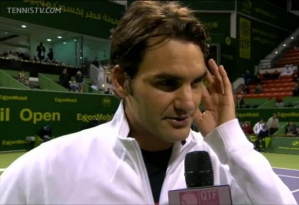 Roger Federer Doha Qatar match interview hand fingers hair white zip up jacket Nike photos pictures images screencaps