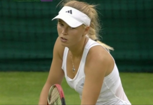 Caro Wozniacki squint like Clint Eastwood Wimbledon 2012 grass white dress photos pictures racquet racket