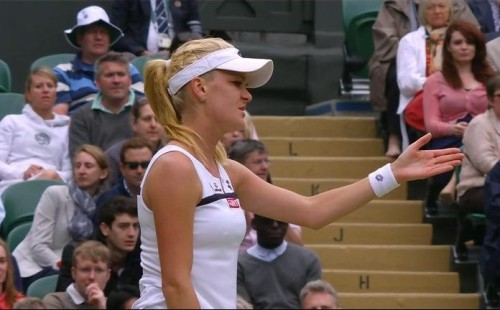 Agnieszka Radwanska Wimbledon Pironkova match outstretched hand disbelief frustration pose white dress visor pictures
