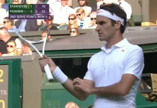 Handsome Roger Federer scratching arm holding racquet returning serve stoic Stakhovsky match Wimby 2013 photos pictures