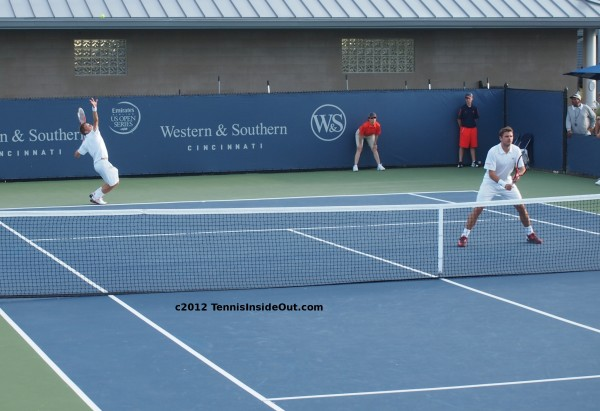 Jarkko Nieminen serving Stanislas Wawrinka at net doubles match Cincinnati Open pics
