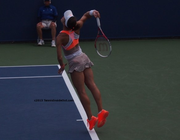 Andrea Petkovic Petko flighing serve Stella McCartney outfit dress orange taupe beige white pictures