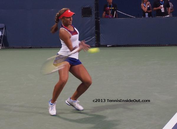 Monica Puig blurred forehand beautiful thighs match against Bouchard Cincinnati Open 2013