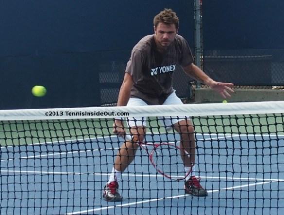 Stan Wawrinka volley at net hands tennis ball sexy sweaty practice Cincy US Open series pictures