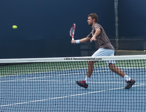 Western and Southern Open US series tennis deft volley chasing tennis ball Stan Wawrinka