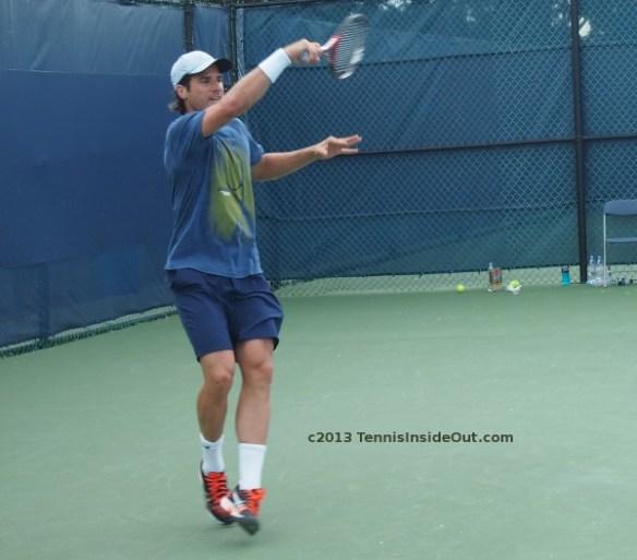 Tommy Haas forehand sweaty blue t-shirt hot guys tiptoes big swing follow through Cincinnati Open