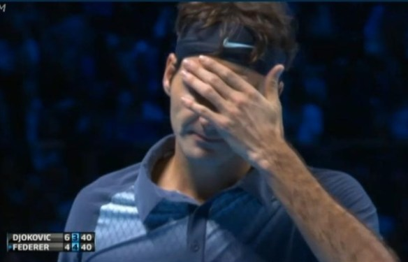 Fed covering face with hand Nole match WTF 2013