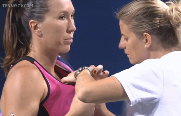 Jelena umpire pinning WTA patch to dress Tokyo 2013