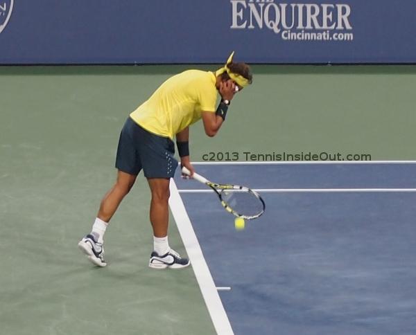 Rafa Nadal yellow shirt rituals tucking hair behind ear Federer match Cincy 2013