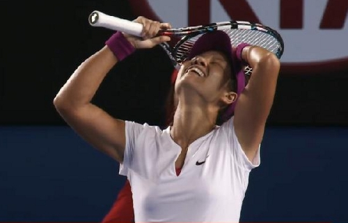 Australian Open champion Li Na exulting relief victory hands on head pose smile