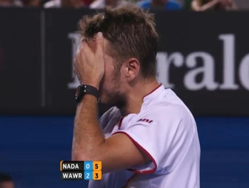 Stanislas Wawrinka Stan the Man hand to face wiping sweat facepalming tough final match against Rafael Nadal AO 2014 pics photos