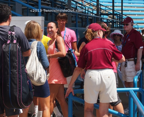 Jelena Jankovic meeting fans grinning smiling signing Cincinnati Open peach dress 2013 photos