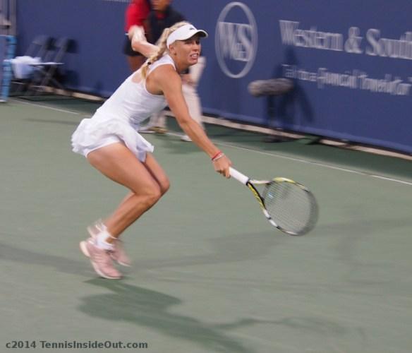 Caroline Wozniacki lunging backhand slice gorgeous thighs ruffled white skirt photos Cincinnati 2014