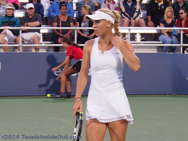 Caroline Wozniacki Caro adjusting necklace white Stella McCartney ruffled dress Western and Southern Open Cincinnati 2014 photos pics images