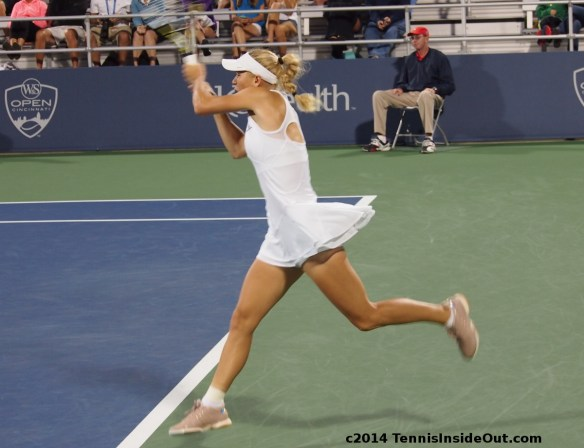 Caro leaping backhand airborne