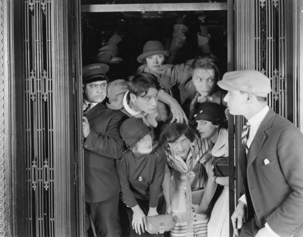 Vintage photo crowded elevator photos