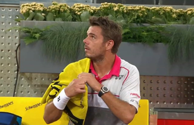 Stan Wawrinka staring up at umpire Fergus Murphy Sousa match towel watch red gray polo